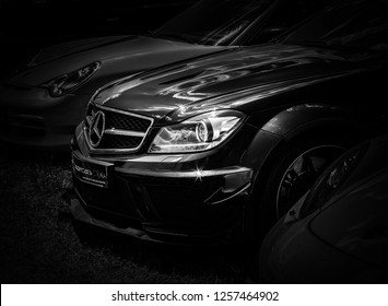 This photo was taken in Le Mans / France - July 7th, 2018 at Le Mans Classic: The front of a modern Mercedes-Benz C63 AMG. Black Series
