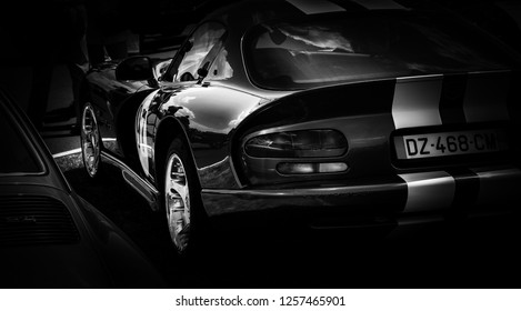 This photo was taken in Le Mans / France - July 7th, 2018 at Le Mans Classic: The back of an American Dodge Viper sports car.