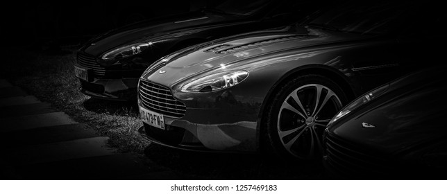 This photo was taken in Le Mans / France - July 7th, 2018 at Le Mans Classic: The front of a modern Aston Martin Vantage V12 super car.
