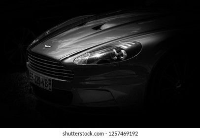 This photo was taken in Le Mans / France - July 7th, 2018 at Le Mans Classic: The front of a modern Aston Martin DBS super car.