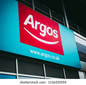 This photo was taken in Loughborough, Leicestershire / United Kingdom - July, 26th 2018: An Argos sign at an Argos storefront