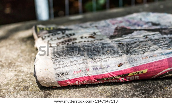 This photo was taken in Matlock, Derbyshire / United Kingdom - July, 31st 2018: A used newspaper.