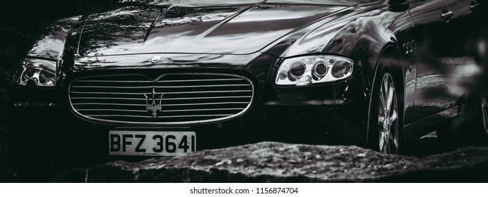 This photo was taken in Nottingham, Attenborough / United Kingdom - July, 22nd 2018: The front grille of a luxury Maserati Quattroporte saloon car