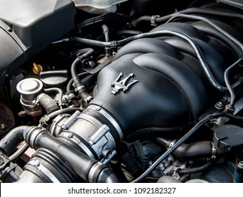 This photo was taken in Nottingham, Nottinghamshire / United Kingdom - May 13, 2018: The engine of a 2007 Maserati Quattroporte sports car.
