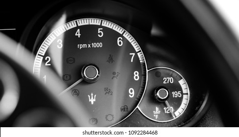 This photo was taken in Nottingham, Nottinghamshire / United Kingdom - May 13, 2018: The rev counter of a Maserati Quattroporte.