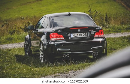 This photo was taken in Nurburgring / Germany - August, 3rd 2014: BMW 1 Series M sports car
