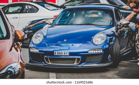 This photo was taken in Nurburgring / Germany - August, 3rd 2014: Blue Porsche 911 GT3 RS sports car