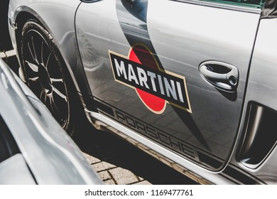 This photo was taken in Nurburgring / Germany - August, 3rd 2014: Martini livery of a Porsche sports car