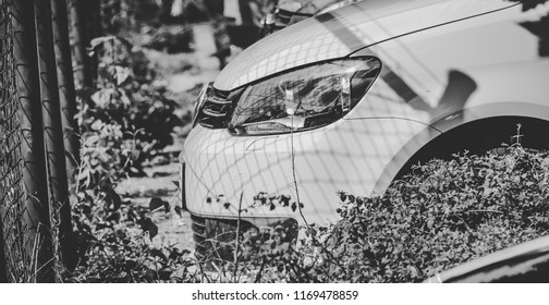 This photo was taken in Nurburgring / Germany - August, 3rd 2014:The headlight of a modern Volkswagen Golf car