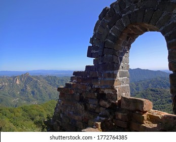 This photo was taken on top of the Great Wall of China in the Mutianyu portion. There are reminants of ruins which have not been repaired.