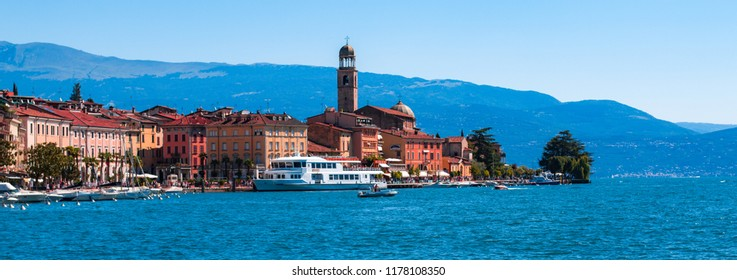 This photo was taken in Salo, Lake Garda / Italy - August, 28th 2018: The small town of Salo with a mountainous background