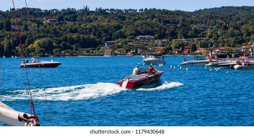 This photo was taken in Salo, Lake Garda / Italy - August, 28th 2018: A vintage, Italian motorboat