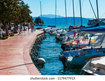 This photo was taken in Salo, Lake Garda / Italy - August, 28th 2018: Yachts docked outside of Salo town centre