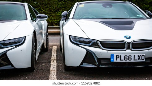 This photo was taken in Silverstone, Northamptonshire / United Kingdom - August 18th, 2018: A couple of modern BMW i8 sports cars