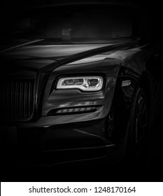 This photo was taken in Silverstone, Northamptonshire / United Kingdom - August 18th, 2018: The front headlight of a modern Rolls Royce Wraith luxury car.