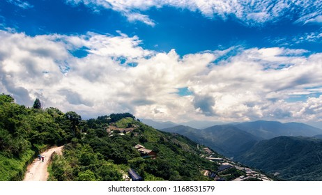 This photo was taken in Taiwan. High up in the mountain, one can see mountain ranges, alpine trees and beautiful cloud formation. One can see really far into the distant. This image is breathtaking.