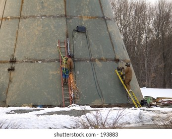 This is a photo of two welders doing their job.