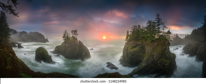 This is a photograph of big sea stacks with trees of Oregon coast taken at sunset hour.