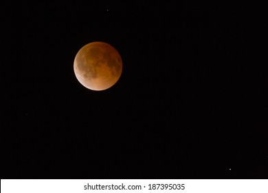 This is a photograph of the Lunar Eclipse Blood Moon Tetrad moving out of its maximum stage at 3:00 am Central Time United States.