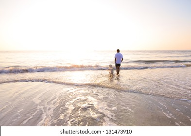This is a photograph of a man and his dog on the beach in the morning , Thailand