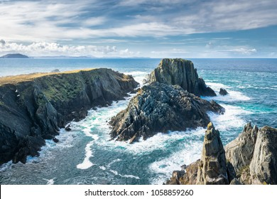 This is a photograph of sea cliffs that are in Malin Head.  the Northern most point in Ireland.  This picture shows the power of the Atlantic Ocean with the waves crashing  upon the rocks below