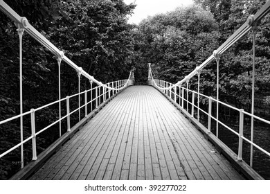 This photograph shows one of the pedestrian bridges that spans the Akers River in Oslo, Norway. The Amot bridge was built in 1851 over the Drammen River and moved to its Oslo in 1962.