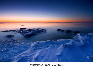 This is photographed after sunrise in the coast of Uutela, Helsinki. There is  ice in foreground and open water with ice float in background.