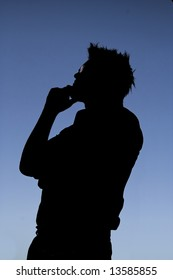 This photographic silhouette has some nice shadow detail. The figure is clearly pondering some deep thought.