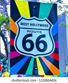 "This is a picture of the legendary route 66.sign Running through West Hollywood. of course it would be the rainbow.  ""66"" continues west on Santa Monica and finishes right in the pier."