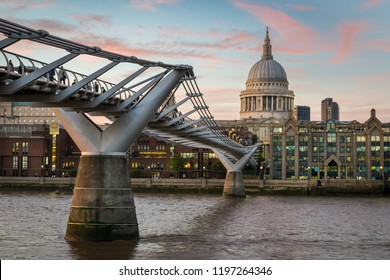 This is a picture of  the Millennium Bridge and St Paul's Catherdral in London at sunset