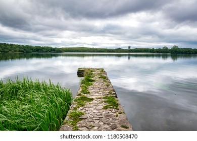 This is a picture of an old stone fishing dock going out in to Lower Lough Erne in Northern Ireland
