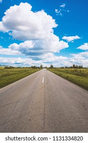 This is a picture of open road and cumulus clouds near city of Vrsac Serbia
