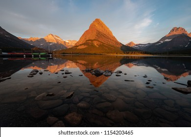 This is the picture of reflection of mountain at Swiftcurrent Lake at Glacier National Park, Montana.