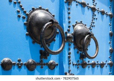 This picture represents detailed door knocker in tunisian arabic style located in beautiful place Sidi Bou Said, Tunisia