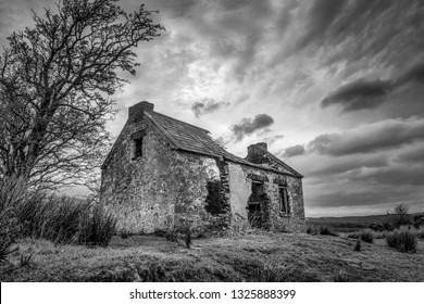 This is a picture of the ruins of an old stone Irish cottage in Donegal Ireland