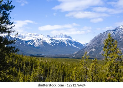 This picture showcases Banff National Park ice mountains and forests of Sundance Canyon.