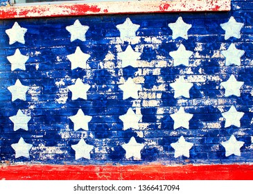 This is a picture of stars and red stripes on an old brick wall.  Red, white and blue flag depiction faded on a wall.  This would be great for Memorial Day or the 4th of July.