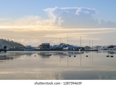 This is a picture taken on the Swedish westcoast in a little fishing town called Grebbestad an early December morning so the archipelago was white. Together with a beautiful sky and clear water!