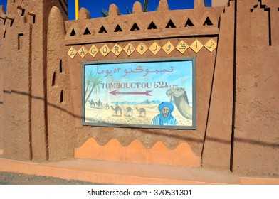 This picture was taken while travelling between Marrakesh and the Atlas Mountains in Morocco.  It was impossible to just drive by.  I had to capture the road sign to the legendary Timbouctou