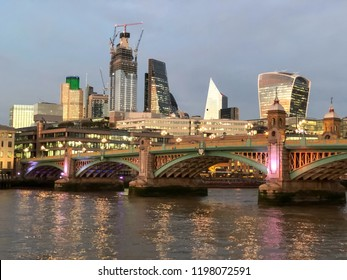 This is a picute of Southwark Bridge in London at Sunset