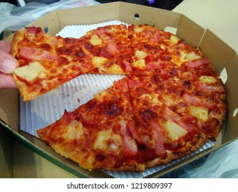 This is a pizza with a thin plate in Thailand.