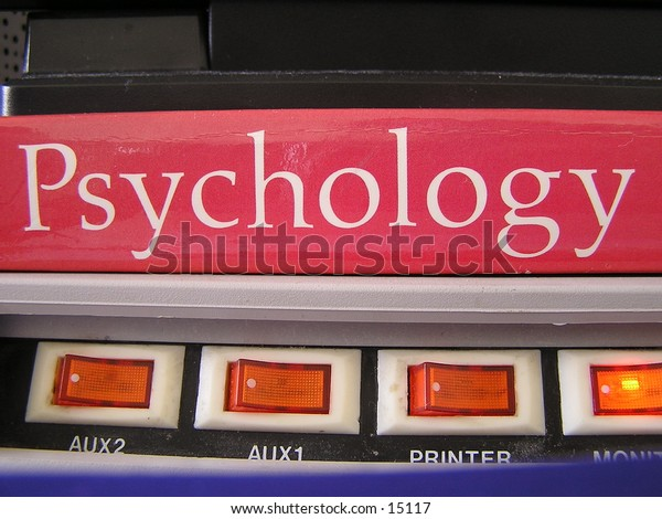 This is a Psychology book on top of a Power Strip