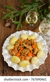 This rabbit stew is a savory combination of cut up rabbit, carrots, and potatoes