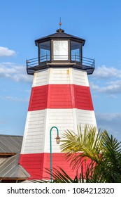 This red an white replica lighthouse overlooks a boardwalk in Madeira Beach, Florida.