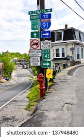 This road sign in the tiny village of Derby Line, VT marks the border between the US and Canada.  The Canadian customs inspection building is visible in the left side of the picture.
