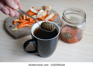 This is a rosebay Willowherb drugs drink named Ivan tea. Selection of natural spice with pine cone syrup in the hot medical drink for immunity and cold prevention. The herbal tea mug on the table.