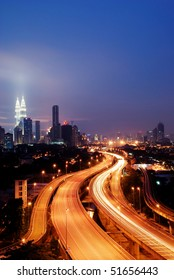 This scenario Kuala Lumpur twin towers, taken with slow shutter speed to get the light trail from the highway traffic.