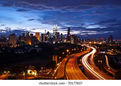 This scenario Kuala Lumpur twin towers, taken with slow shutter speed to get the light trail from the highway traffic.  lightrail view of Kuala Lumpur city