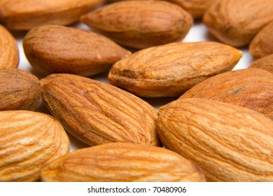 This is a shot of a pile of almonds shot with a shallow depth of field on an isolated white background.