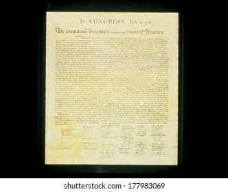 This shows the original Declaration of Independence in its entirety written on its now faded parchment paper.